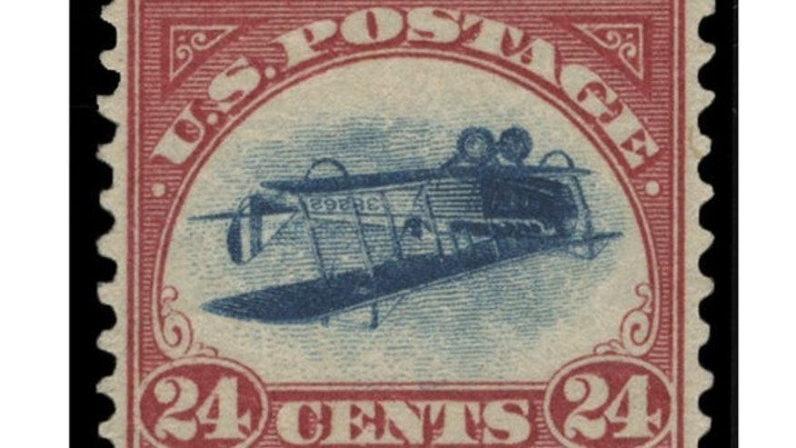 "This undated photo provided by Spink, USA, shows a 1918 ""inverted Jenny"" stamp that was stolen in 1955. (Spink USA via AP)"