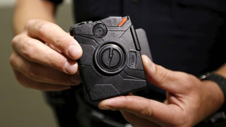 Aug. 31, 2015: LAPD information technology bureau officer Jim Stover demonstrates the use of the body camera during a media event displaying the new body cameras to be used by the Los Angeles Police Department in Los Angeles.