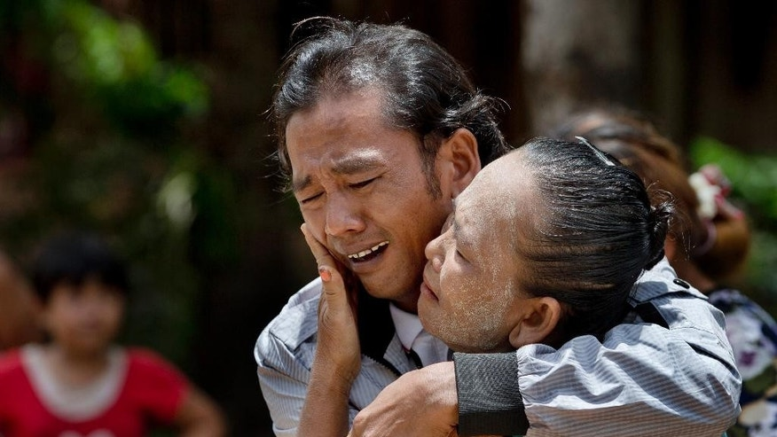 FILE - In this May 16, 2015, file photo, former slave fisherman Myint Naing and his mother, Khin Than, cry as they are reunited after 22 years at their village in Mon State, Myanmar. The Associated Press has won the Pulitzer Prize on Monday, April 18, 2016 for public service for articles documenting the use of slave labor in the commercial seafood industry in Indonesia and Thailand. (AP Photo/Gemunu Amarasinghe, File)