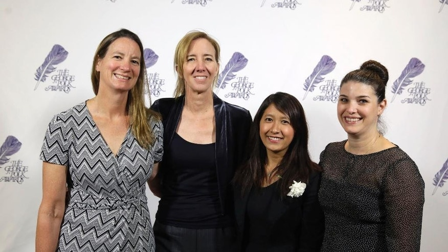 In this April 8, 2016 photo, the Associated Press team that investigated seafood caught by slaves poses, from left, Martha Mendoza, Robin McDowell, Esther Htusan and Margie Mason, at the George Polk Award luncheon in New York. The team won the Pulitzer Prize for public service announced Monday, April 18, 2016. (AP Photo/Richard Drew)