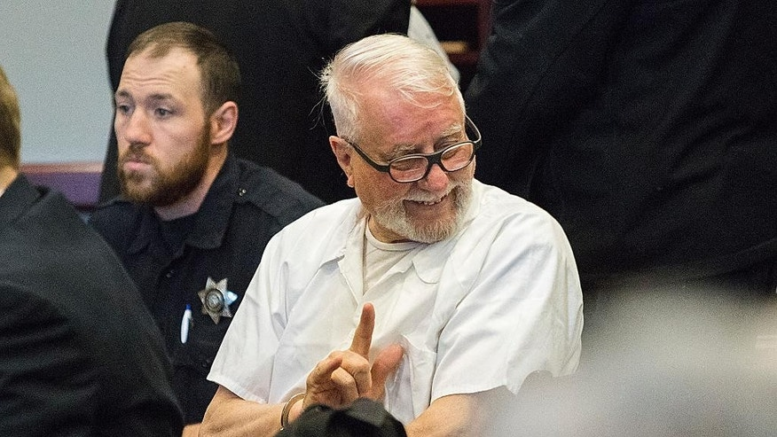"Jack McCullough gives his stepdaughter Janey O'Connor the sign of ""I love you"" as he sits during a hearing in the DeKalb County Courthouse on Friday, April 15, 2016 in Sycamore, Ill. McCullough who a prosecutor says was wrongly convicted in the 1957 killing of an Illinois schoolgirl was released Friday shortly after a judge vacated his conviction, meaning that one of the oldest cold cases to be tried in U.S. history has officially gone cold again. (Danielle Guerra/Daily Chronicle via AP) MANDATORY CREDIT; CHICAGO TRIBUNE OUT"