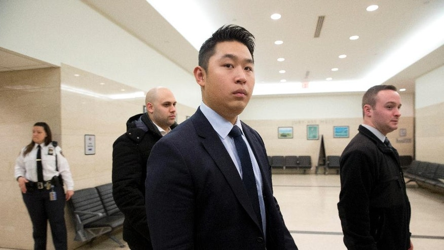 FILE - In this Feb. 9, 2016 file photo, former New York City police officer Peter Liang, center, returns to the courtroom after a break in his trial on charges in the shooting death of Akai Gurley, at Brooklyn Supreme court in New York. Liang was fired from the police force shortly after the February jury verdict in the death of Gurley. Liang will find out if he's going to prison during sentencing on Tuesday, April 19, following his manslaughter conviction in the accidental shooting death of the unarmed man in a darkened stairwell. (AP Photo/Mary Altaffer, File)
