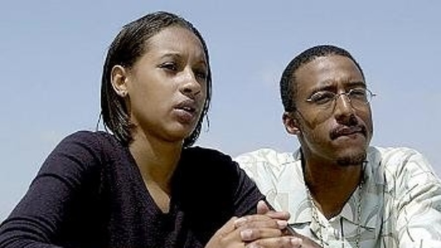 Tieray Jones, right, with his wife, Tameka, in 2002.