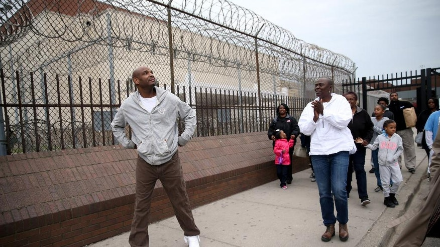 Eddie Bolden takes his first steps as a free man outside the Cook County Jail, after his release from prison,on Tuesday, April 19, 2016, in Chicago. A Cook County judge threw out the murder convictions of the long time inmate, and prosecutors declined to retry him. (Erin Hooley/Chicago Tribune via AP)