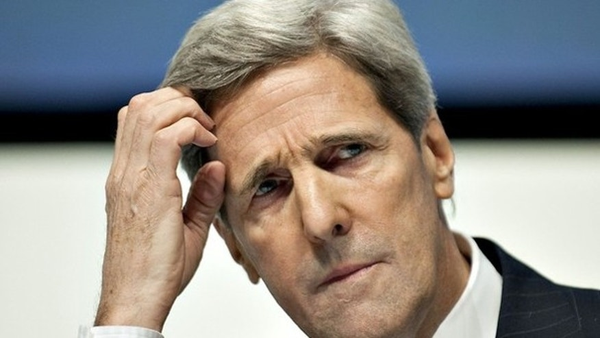 Sen. John Kerry reacts at a news conference at the U.N. Climate Change Conference in Copenhagen Dec. 16. (Reuters Photo)
