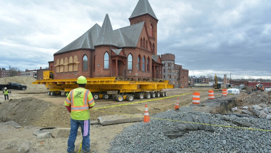 April 19, 2016: Workers move the historic 129-year-old First Spiritualist Church from its Bliss Street location to a nearby Union Street site in Springfield, Mass.