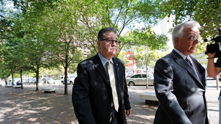 Former New Orleans Police Former Sgt. Arthur Kaufman arrives at Federal Court in New Orleans, Wednesday, April 20, 2016. Five former New Orleans police officers are expected to enter pleas to reduced charges in the deadly shootings on a bridge in the days that followed Hurricane Katrina in 2005. Kaufman, who was not involved in the shooting, faces a new trial in the cover-up alone. (AP Photo/Gerald Herbert)