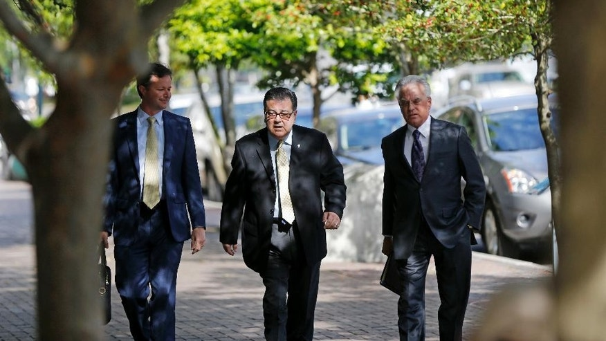 Former New Orleans Police Former Sgt. Arthur Kaufman, center, arrives at Federal Court in New Orleans, Wednesday, April 20, 2016. Five former New Orleans police officers are expected to enter pleas to reduced charges in the deadly shootings on a bridge in the days that followed Hurricane Katrina in 2005. Kaufman, who was not involved in the shooting, faces a new trial in the cover-up alone. (AP Photo/Gerald Herbert)