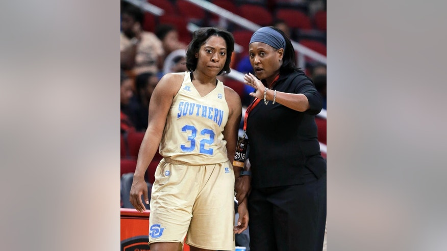 "FILE - In this March 12, 2016, file photo, Southern University coach Sandy Pugh, right, talks to Miaya Crowder during the second half of an NCAA college basketball game in the championship game of the Southwestern Athletic Conference tournament in Houston, Texas. The NCAA's new Academic Progress Rate, released Wednesday, April 20, 2106, shows a record number of college athletes are staying in school and working toward degrees, and that money continues to play a key role in academic performance. Of the 68 Division I teams falling below the 930 cutline, 81 percent were described as ""low-resource"" institutions, 85 percent were Historically Black Colleges and Universities and 22 of the 23 teams facing postseason bans, including Southern. (AP Photo/Pat Sullivan, File)"