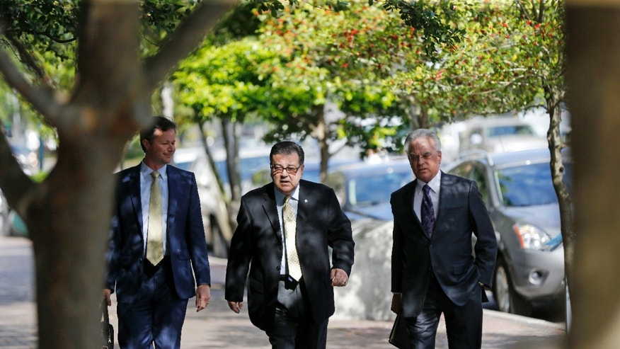 Former New Orleans Police Sgt. Arthur Kaufman, center, arriving to court.