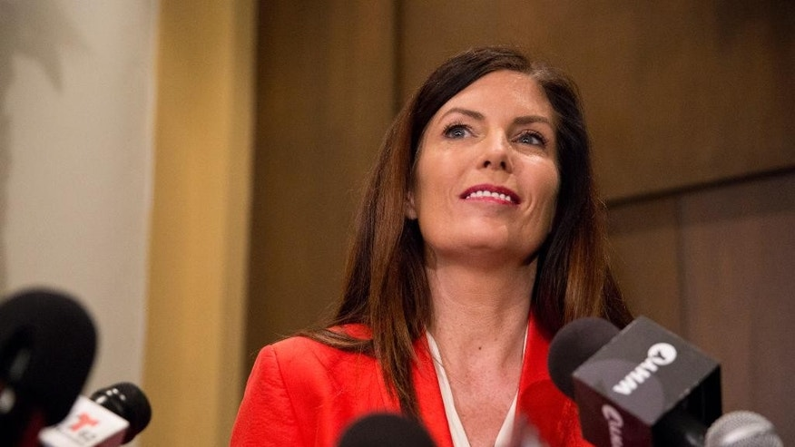 FILE - In this Feb. 16, 2016 file photo, Pennsylvania Attorney General Kathleen Kane announces she will not seek a second term, facing pressure from within her own party after being hobbled for months by criminal perjury charges and the suspension of her law license, during a press conference at her regional office in Scranton, Pa. Kane wants a judge to explore whether prosecutors leaked FBI recordings in her criminal case to a newspaper. Kane is due in court Wednesday, April 20, 2016, in Montgomery County for a pretrial hearing in her grand jury leak case.  (Christopher Dolan/The Times & Tribune via AP, File)  WILKES BARRE TIMES-LEADER OUT; MANDATORY CREDIT