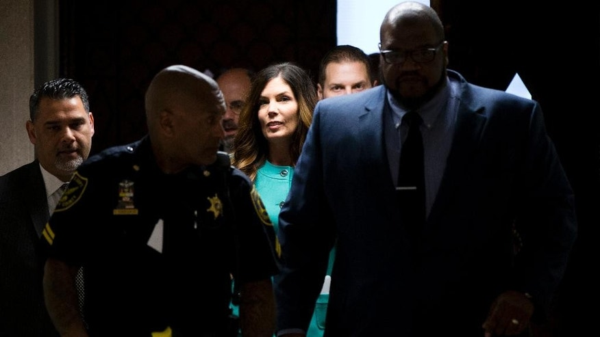 Pennsylvania Attorney General Kathleen Kane, center, departs after a pretrial hearing in her grand jury leak case, Wednesday, April 20, 2016, at the Montgomery County courthouse in Norristown, Pa. Kane is accused of leaking secret grand jury information to the press, lying under oath and ordering aides to illegally snoop through computer files to keep tabs on an investigation into the leak. (AP Photo/Matt Rourke)