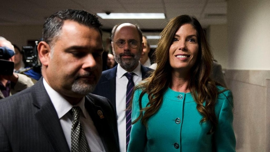 Pennsylvania Attorney General Kathleen Kane departs after a pretrial hearing in her grand jury leak case, Wednesday, April 20, 2016, at the Montgomery County courthouse in Norristown, Pa. Kane is accused of leaking secret grand jury information to the press, lying under oath and ordering aides to illegally snoop through computer files to keep tabs on an investigation into the leak. (AP Photo/Matt Rourke)