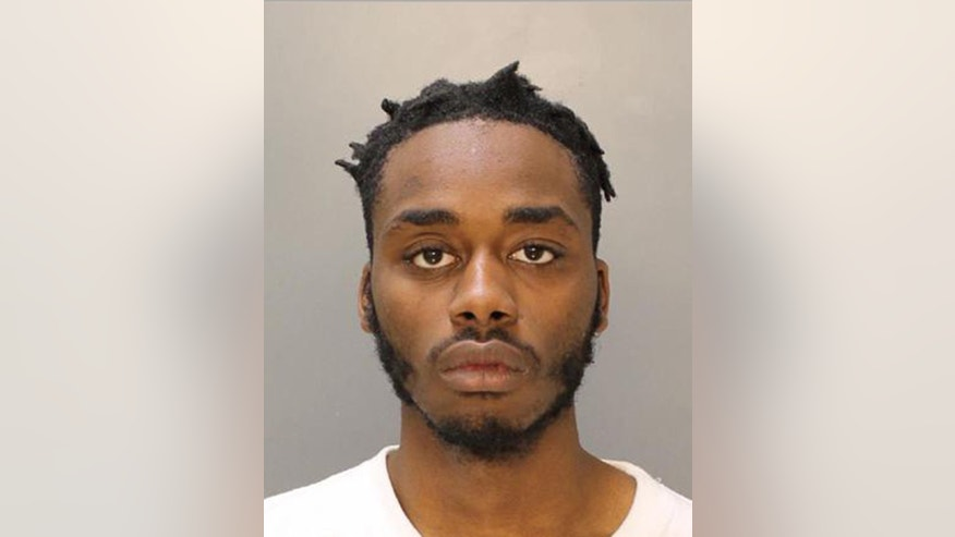 This undated photo provided by the Philadelphia Police Department shows Scott Griffin, who authorities say is a 23-year-old Philadelphia resident arrested Monday, April 18, 2016, after he was identified as the man suspected of shooting police officer James McCullough on Sunday. McCullough, shot while trying to stop a carjacking, was released from the hospital Monday. He was arraigned early Wednesday on attempted murder, robbery and related charges.(Philadelphia Police Department via AP)