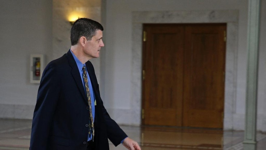 Washington State Auditor Troy Kelley leaves the federal courthouse during a court recess, Tuesday, April 19, 2016, in Tacoma, Wash. Testimony concluded in Kelley's five-week fraud trial Tuesday, and U.S. District Judge Ronald Leighton said closing arguments will begin Wednesday following jury instructions. (AP Photo/Ted S. Warren)