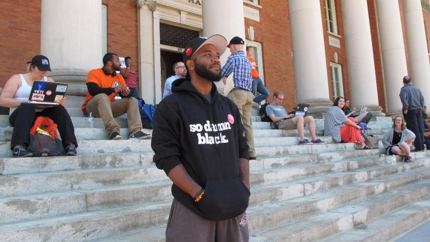 Clemson University graduate student A.D. Carson stands with other students during a sit-in protest about diversity at Sikes Hall on Monday, April 18, 2016, in Clemson, SC. Students have spent a week at Sikes Hall, calling for Clemson to be more diverse. (AP Photo/Jeffrey Collins)