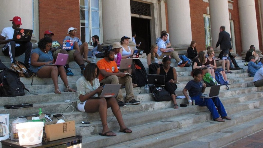 Clemson University students stage a sit-in protest calling for more diversity on Monday, April 18, 2016, in Clemson, SC. Students have spent a week at Sikes Hall. (AP Photo/Jeffrey Collins)