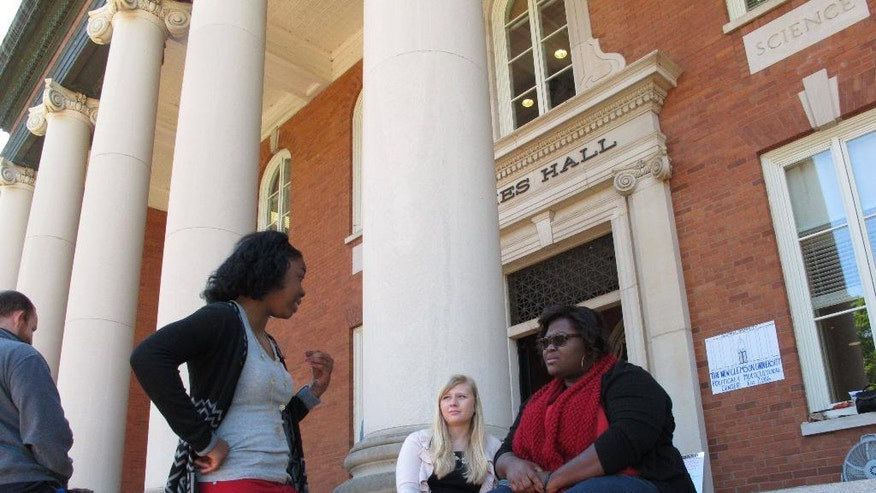 Clemson University junior political science major Rae-Nessha White, left, talks to other students during a sit-in protest about diversity on Monday, April 18, 2016, in Clemson, SC. Students have spent a week at Sikes Hall, calling for Clemson to be more diverse. (AP Photo/Jeffrey Collins)