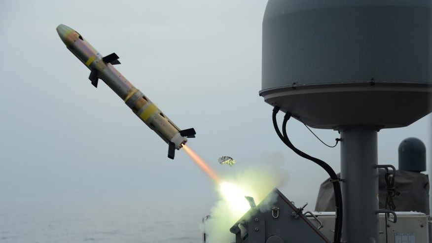 "In this photo released on March 20, 2014 by the U.S. Navy, patrol coastal ship USS Typhoon launches a surface-to-surface missile during Griffin missile exercise to guard against small boat threats in the U.S. 5th Fleet Area of responsibility. A U.S. Navy investigative report obtained by The Associated Press shows a Navy officer relieved of commanding a Persian Gulf patrol ship failed to maintain equipment to the point of exposing ""his crew to unnecessary risk,"" interfered with an inquiry into his actions and once slept drunk on a bench at a Dubai port. The report outlines the allegations against the officer's actions, whom the Navy removed from the USS Typhoon in March. (Mass Communication Specialist 1st Class Doug Harvey, U.S. Navy via AP)"