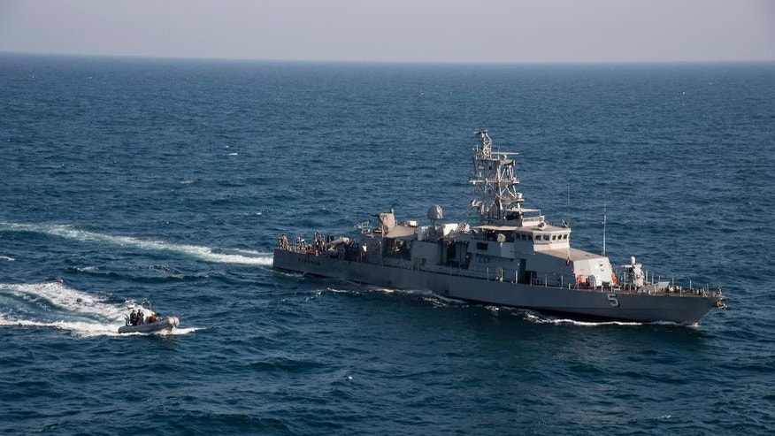 "In this photo released by the U.S. Navy on Feb. 21, 2014, a rigid hull inflatable boat transits alongside the coastal patrol ship USS Typhoon during a vertical onboard deliver exercise in the Arabian Gulf. A U.S. Navy investigative report obtained by The Associated Press shows a Navy officer relieved of commanding a Persian Gulf patrol ship failed to maintain equipment to the point of exposing ""his crew to unnecessary risk,"" interfered with an inquiry into his actions and once slept drunk on a bench at a Dubai port. The report outlines the allegations against the officer's actions, whom the Navy removed from the USS Typhoon in March, 2016.(Mass Communication Specialist 1st Class Martin Cuaron, U.S. Navy via AP)"