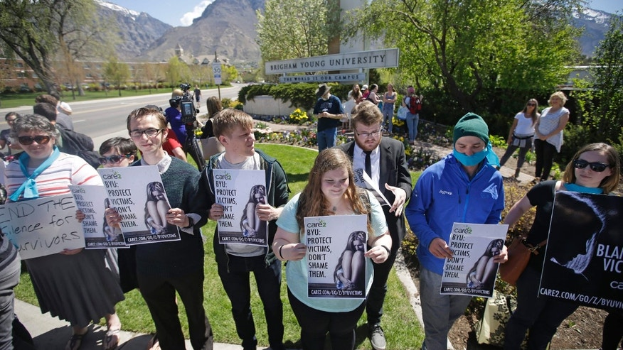April 20, 2016: Protesters stand in solidarity with rape victims on the campus of Brigham Young University during a sexual assault awareness demonstration in Provo, Utah.