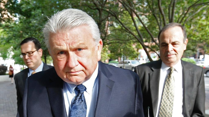Harry Morel, a former district attorney for St. Charles Parish, La., arrives with his attorney Ralph Capitelli, right, at Federal Court in New Orleans.