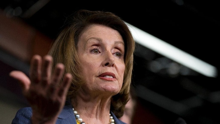 House Minority Leader Nancy Pelosi of Calif., together with House Democrats, speaks to reporters during a news conference on Capitol Hill in Washington, Wednesday, April 20, 2016. (AP Photo/Manuel Balce Ceneta)