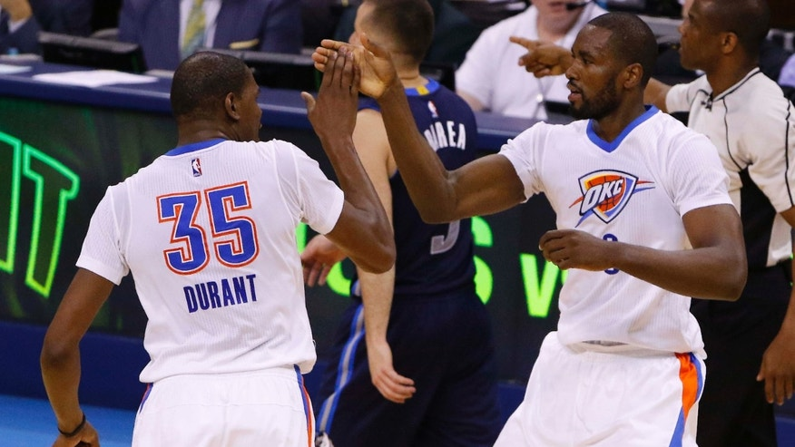 April 16, 2016: Oklahoma City Thunder forwards Kevin Durant (35) and Serge Ibaka (9) high-five during the first half against the Dallas Mavericks in Game 1 of a first-round NBA basketball playoff series in Oklahoma City.