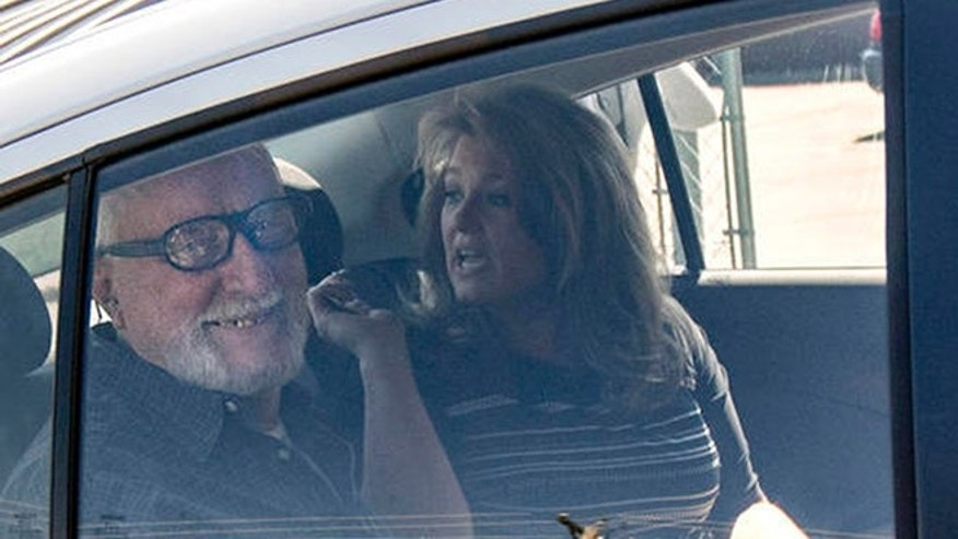 Jack McCullough, left, smiles from the backseat of his stepdaughter Janey O'Connor's rental car after he was released from the DeKalb County Jail in Sycamore, Ill., Friday, April 15, 2016. An Illinois judge vacated the conviction of the 76-year-old man in a 1957 killing and ordered his immediate release from prison Friday, meaning that one of the oldest cold cases to be tried in U.S. history has officially gone cold again. (Danielle Guerra/Daily Chronicle via AP) MANDATORY CREDIT; CHICAGO TRIBUNE OUT