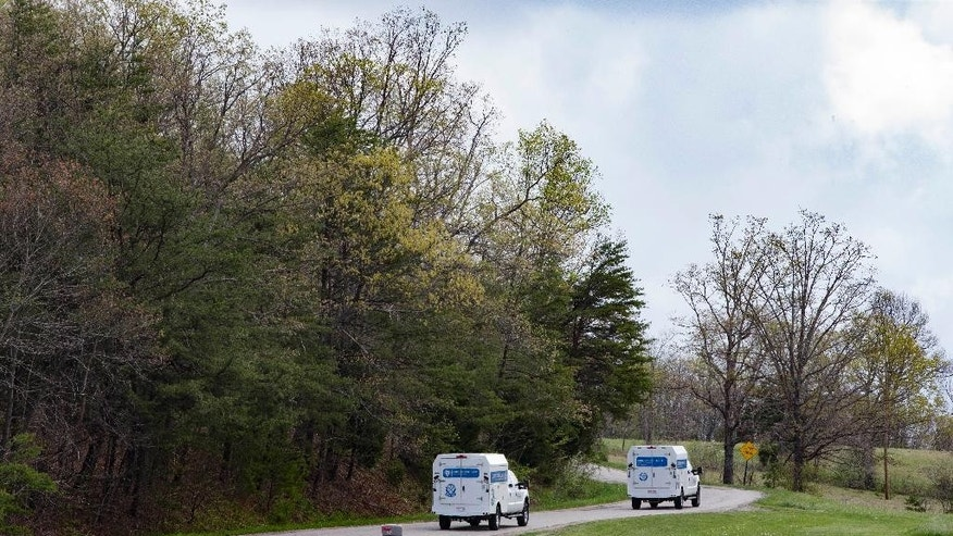 Crime scene investigation vehicles drive up Union Hill Road as they approach the location of a reported multiple shooting, Friday, April 22, 2016, in Pike County, Ohio. Shootings with multiple fatalities were reported along a road in rural Ohio on Friday morning, but details on the number of deaths and the whereabouts of the suspect or suspects weren't immediately clear. The attorney general's office said a dozen Bureau of Criminal Investigation agents had been called to Pike County, an economically struggling area in the Appalachian region some 80 miles east of Cincinnati. (AP Photo/John Minchillo)