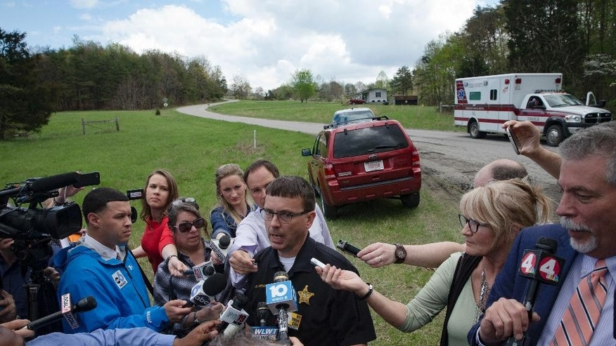 Lt. Michael Preston, of the Ross County Sheriff's Department speaks to the media on Union Hill Road that approaches a crime scene, Friday, April 22, 2016, in Pike County, Ohio. Shootings with multiple fatalities were reported along the road in rural Ohio on Friday morning, but details on the number of deaths and the whereabouts of the suspect or suspects weren't immediately clear. The attorney general's office said a dozen Bureau of Criminal Investigation agents had been called to Pike County, an economically struggling area in the Appalachian region some 80 miles east of Cincinnati. (AP Photo/John Minchillo)