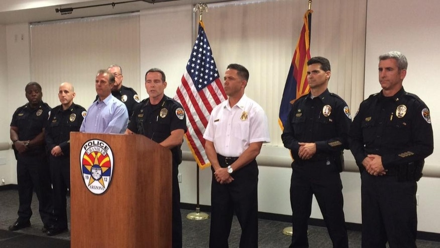 Chandler Police Chief Sean Duggan speaks on the shooting of two officers at a news conference at police headquarters in Chandler, Ariz., on Saturday, April 23, 2016. Two officers are in stable condition, with one requiring surgery, and the suspect is dead following a shooting Saturday at a Walmart in suburban Phoenix, authorities said. Mitchell Oakley, 24, was killed after opening fire at officers who were responding to a call about a trespasser, Chandler police said.  (AP Photo/Terry Tang)