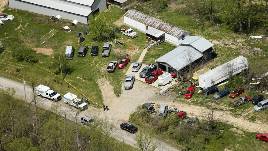 This aerial photo shows one of the locations being investigated in Pike County, Ohio, as part of an ongoing homicide investigation, Friday, April 22, 2016.  Several people were found dead Friday at multiple crime scenes in rural Ohio, and at least most of them were shot to death, authorities said. No arrests had been announced, and it's unclear if the killer or killers are among the dead. (Lisa Marie Miller/The Columbus Dispatch via AP) MANDATORY CREDIT