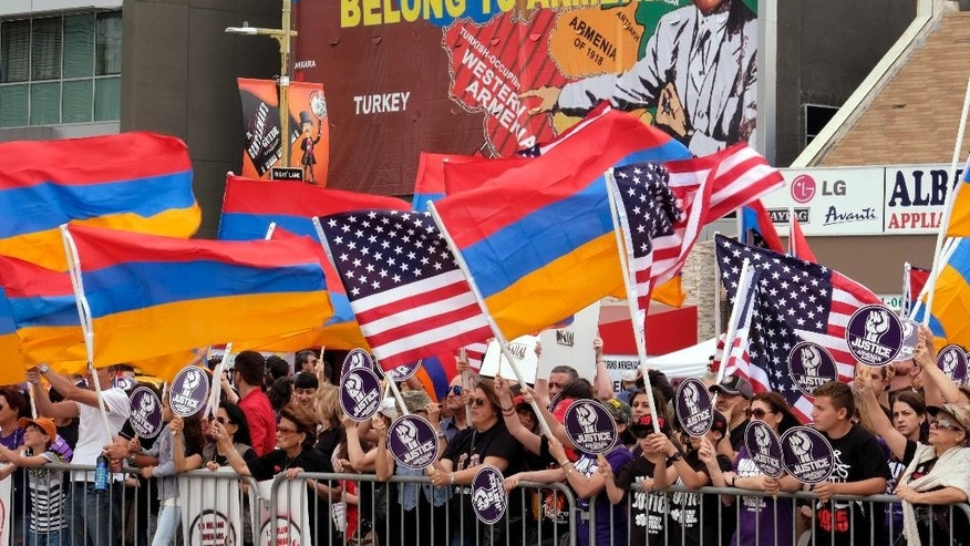Demonstrators rally outside the Turkish Consulate to commemorate the killings of an estimated 1.5 million Armenians under the Ottoman Empire more than a century ago, in Los Angeles on Sunday, April 24, 2016. Historians estimate that up to 1.5 million Armenians were killed starting in April 1915. Turkey denies the killings were genocide and contends those who died were victims of civil war and unrest. Turkey also insists the death toll has been inflated. (AP Photo/Richard Vogel)