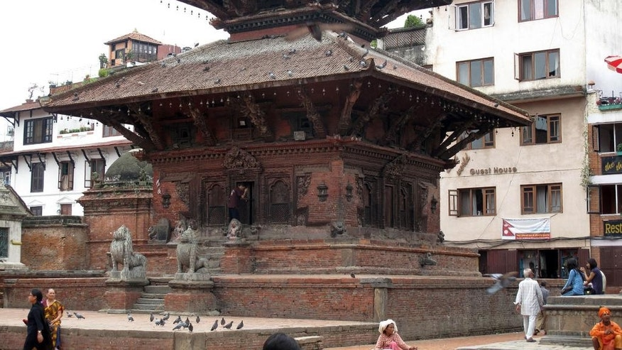 This 3013 photo provided by the World Monuments Fund shows the Char Narayen Temple in Patan, Nepal that was destroyed in 2015 in a massive earthquake. One year to the day after the earthquake claimed 9,000 lives, the New York-based preservation group, the World Monuments Fund, has announced grants totaling $1 million for five historic sites, including the 16th century temple that will be 90 percent rebuilt with salvaged pieces and seismically retrofitted. (Rohit Ranjitkar/Kathmandu Valley Preservation Trust & World Monuments Fund via AP)