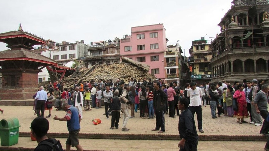 This April 25, 2015 photo provided by the World Monuments Fund shows the Char Narayen Temple in Patan, Nepal immediately after it was destroyed in a massive earthquake. One year to the day after the earthquake claimed 9,000 lives, the New York-based preservation group, the World Monuments Fund, has announced grants totaling $1 million for five historic sites, including the 16th century temple that will be 90 percent rebuilt with salvaged pieces and seismically retrofitted. (Suresh Lakhe/Kathmandu Valley Preservation Trust & World Monuments Fund via AP)