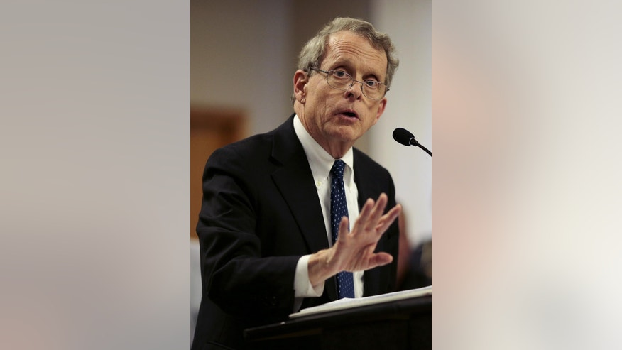"FILE- In this April 22, 2016, file photo, Ohio State Attorney General Mike DeWine speaks during a news conference in Piketon, Ohio. Authorities are scrambling to determine who killed eight family members in a ""pre-planned execution"" that has shaken residents of their rural southern Ohio community. DeWine on Sunday, April 24, described the killings near the small community of Piketon as ""a sophisticated operation."" (Sam Greene/The Cincinnati Equirer via AP, File) MANDATORY CREDIT; NO SALES"