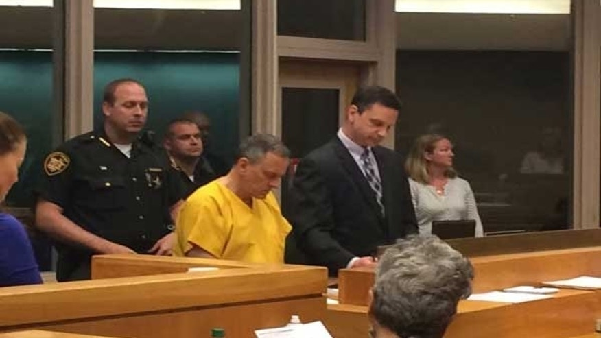 Jeffrey Hawkins seated in court.