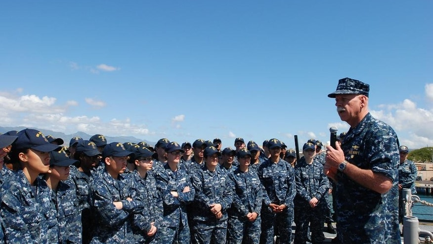 U.S. Pacific Fleet commander Adm. Scott Swift, right, talks to sailors on board the USS Momsen in Pearl Harbor, Hawaii on Tuesday, April 26, 2016. The U.S. Pacific Fleet commander says he plans to expand the role of the U.S. 3rd Fleet commander and her staff. (AP Photo/Audrey McAvoy)