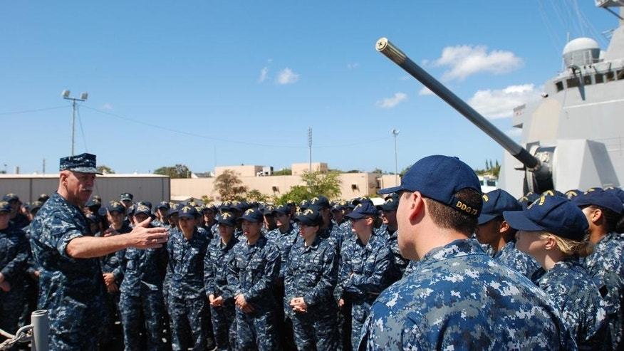 U.S. Pacific Fleet commander Adm. Scott Swift, left, talks to sailors on board the USS Momsen in Pearl Harbor, Hawaii, on Tuesday, April 26, 2016. The U.S. Pacific Fleet commander says he plans to expand the role of the U.S. 3rd Fleet commander and her staff. (AP Photo/Audrey McAvoy)
