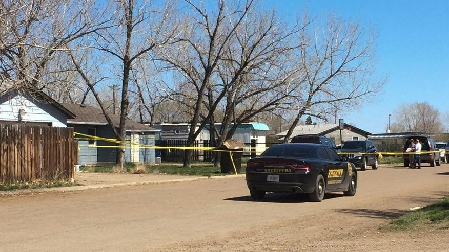 A sheriff's department vehicle is parked outside the house where 1-year-old Kenzley Olson was staying when she was beaten to death on Friday, April 22, 2016, in Poplar, Mont. A federal investigator says a woman beat to death the girl on a Montana Indian reservation and threw the baby's body into a dumpster. Janelle Red Dog appeared in Fort Peck Tribal Court on Friday in the death of Olson after she reportedly confessed and drew a map of where the body was located. (AP Photo/Richard Peterson)