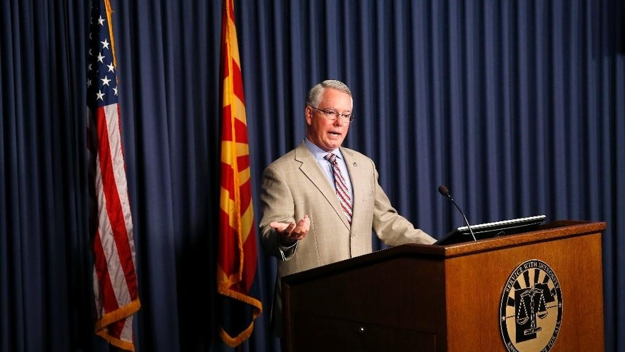 Maricopa County District Attorney Bill Montgomery discusses charges against Leslie Merritt Jr. being dropped in the freeway shootings case during his weekly news conference, Wednesday, April 27, 2016 in Phoenix. Montgomery says he'll press ahead with the case despite dropping the charges against the suspect. (AP Photo/Matt York)