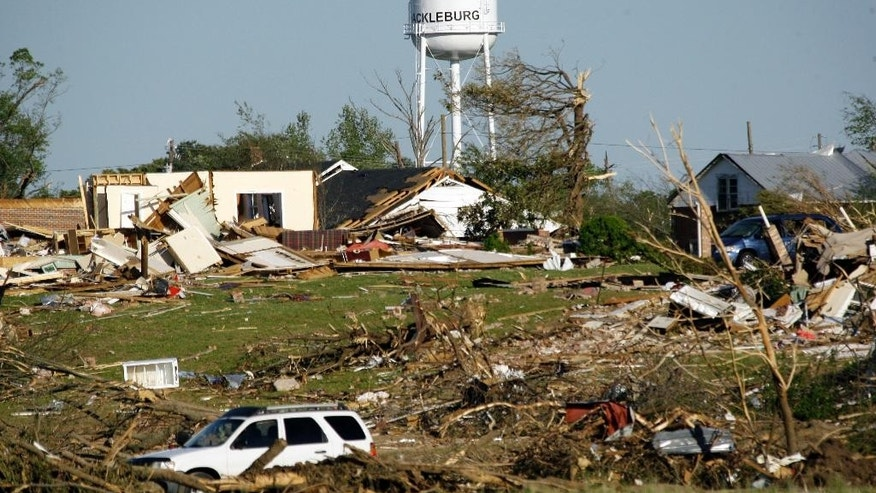FILE - In this April 29, 2011 file photo, a water tower stands amid the damage in Hackleburg, Ala. On April 27, 2011, a series of tornadoes killed hundreds of people, injured thousands and reduced countless buildings to rubble across a swath of the U.S. A tornado left physical scars in the town of Hackleburg, and it???s still taking a psychological and social toll today. (AP Photo/Rogelio V. Solis, File)