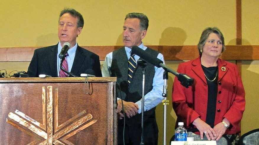 Michael Goldberg, left, federal receiver appointed to run two Vermont ski resorts amid fraud allegations, speaks Wednesday April 27, 2016 in Jay, Vt., beside Vermont Gov. Peter Shumlin, center, and Commerce Secretary Patricia Moulton. Goldberg said there's enough cash to keep the Jay Peak resort operating. The other ski area, Q Burke Mountain resort, is expected to open in the fall. (AP Photo/Lisa Rathke)