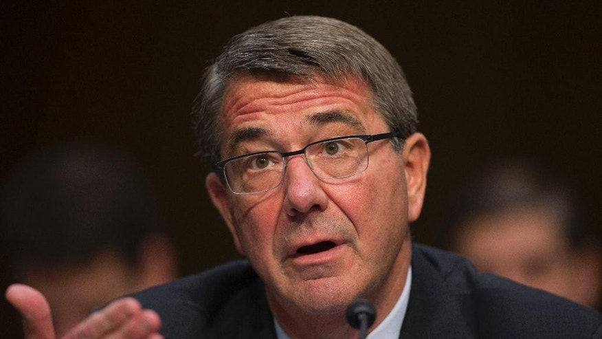 Defense Secretary Ash Carter testifies on Capitol Hill in Washington, Thursday, April 28, 2016, before the Senate Armed Services Committee hearing on the Islamic State group. (AP Photo/Evan Vucci)