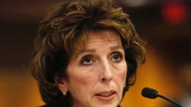 FILE - In this Dec. 14, 2011 file photo, University of California, Davis, Chancellor Linda Katehi, told lawmakers  that she never ordered campus police to use force or pepper spray on students last month, while testifying at a legislative hearing at the Capitol in Sacramento, Calif. Katehi has been placed on leave amid an uproar stemming in part from the school's hiring of consultants to improve its image, following a widely criticized protest pepper spraying incident by police. UC President Janet Napolitano's office announced Wednesday, April 27, 2016, that she is appointing an outside investigator to determine whether the actions of Chancellor Katehi have violated university policies.  (AP Photo/Rich Pedroncelli, File)