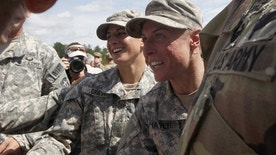 Capt. Kristen Griest of Orange, Connecticut (L) and 1st Lt. Shaye Haver of Copperas Cove, Texas (R) are congratulated at Ranger school graduation at Fort Benning in Columbus, Georgia August 21, 2015.  The two pioneering women made history on Friday as they became the first females to graduate from the Army's elite and grueling 62-day Ranger school, at Fort Benning, Georgia. Though Haver and Griest are still not eligible to take part in front-line combat, according to reports, a decision on whether to change that policy could come in the fall.. REUTERS/Tami Chappell   - RTX1P4A7