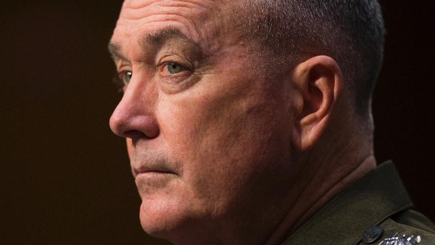 Joint Chiefs Chairman Gen. Joseph Dunford listens while testifying on Capitol Hill in Washington, Thursday, April 28, 2016, before the Senate Armed Services Committee hearing on the Islamic State group. Sen. John McCain, R-Ariz., the chairman of the GOP-led Armed Services Committee is calling the U.S. response to the extremists reactive, slow, and insufficient. (AP Photo/Evan Vucci)