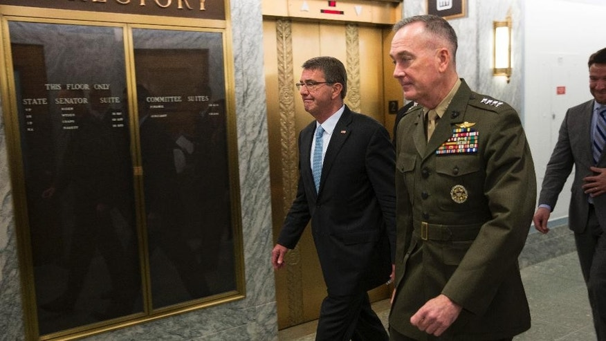 Defense Secretary Ash Carter, left, and Joint Chiefs Chairman Gen. Joseph Dunford walk in the Dirksen Senate Office building on Capitol Hill in Washington, Thursday, April 28, 2016, after testifying before the Senate Armed Services Committee hearing on the Islamic State group. (AP Photo/Evan Vucci)