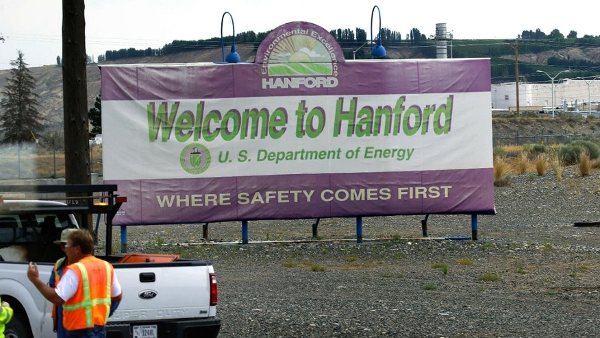 "FILE - This July 9, 2014 file photo shows a sign that says ""Where Safety Comes First"", which welcomes visitors to the Hanford Nuclear Reservation near Richland, Wash."